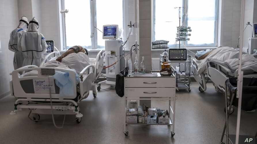 Doctors attend to a patient inside the intensive care unit for people infected with the new coronavirus, at a hospital in Moscow, Russia, May 2, 2020.