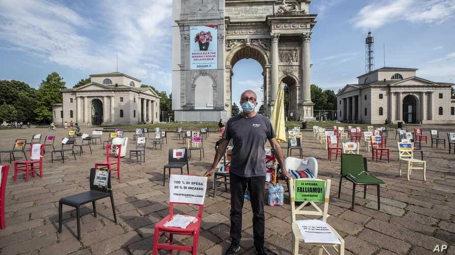 Restaurant owner Paolo Polli stages a protest in Milan, Italy, Saturday May, 9, 2020.