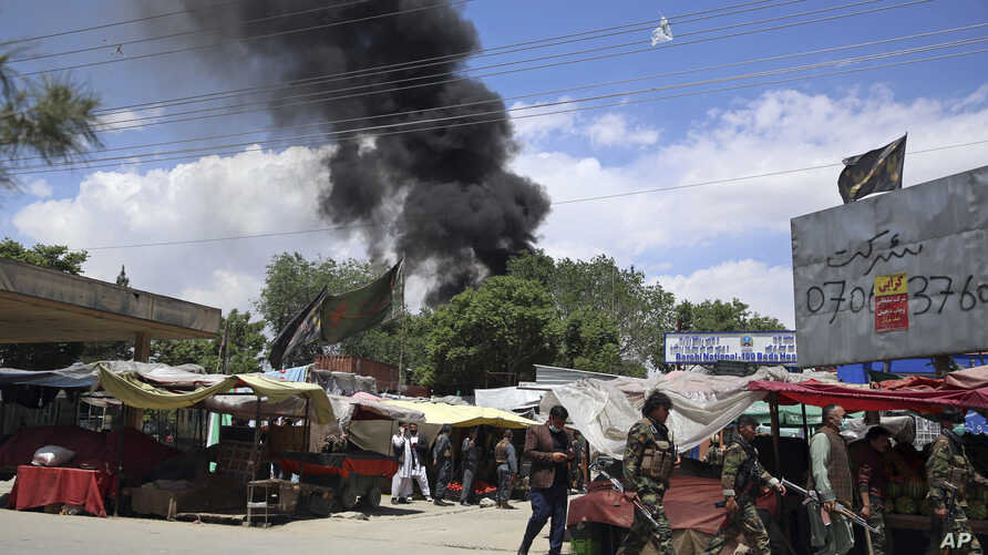Smokes rises from a maternity hospital, after gunmen attacked in Kabul, Afghanistan, Tuesday, May 12, 2020. Gunmen stormed the…