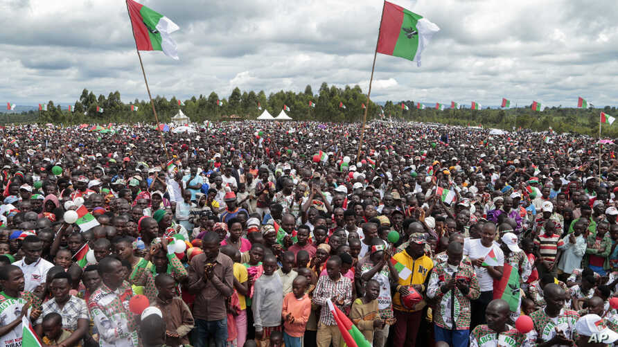 Crowds of supporters of the ruling party gather for the start of the election campaign, in Bugendana, Burundi. Burundi is expelling WHO's top official in the country Walter Kazadi Mulombo and three experts, saying they must leave by Friday, May 15, 2020.