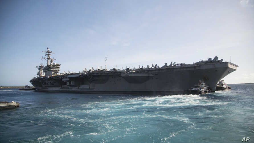 The aircraft carrier USS Theodore Roosevelt (CVN 71) departs Apra Harbor at Naval Base Guam on Thursday, May 21, 2020, following an extended visit to Guam in the midst of the COVID-19 pandemic.