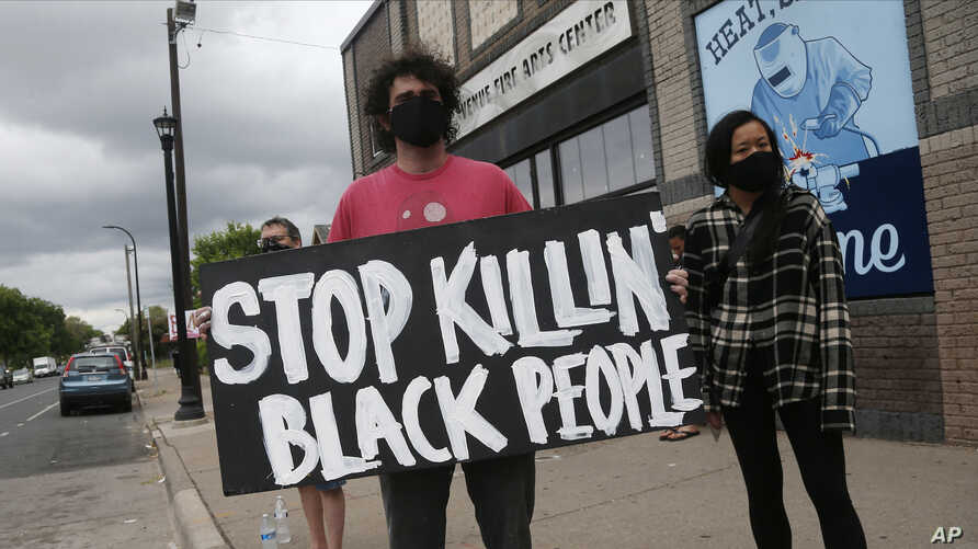 Protesters gather near the site of the death of a man, Tuesday, May 26, 2020, who died in police custody Monday night in…
