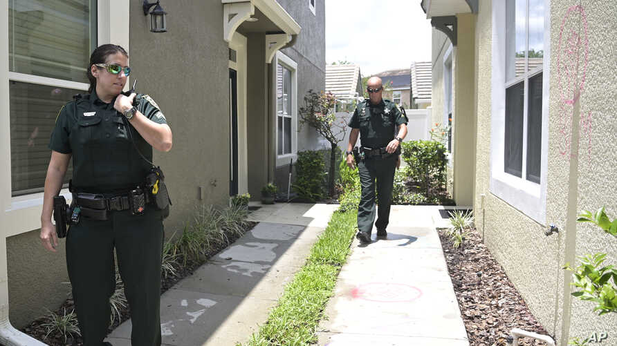 Orange County Sheriff's deputies check on a townhouse owned by Minneapolis police officer Derek Chauvin, May 29, 2020.