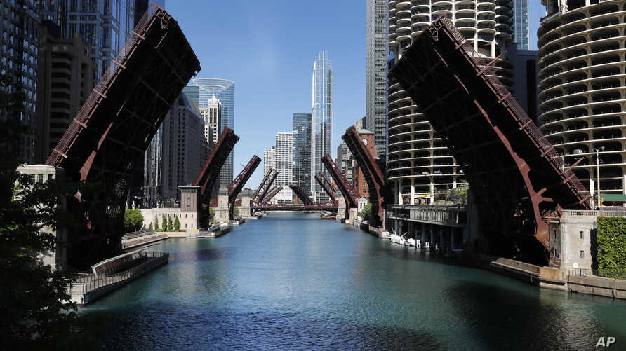 Several street bridges over the Chicago River remain closed early Sunday morning, May 31, 2020 in Chicago.