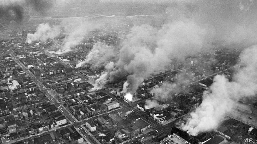 FILE - In this April 5, 1968 file photo, buildings burn along H Street in the northeast section of Washington.