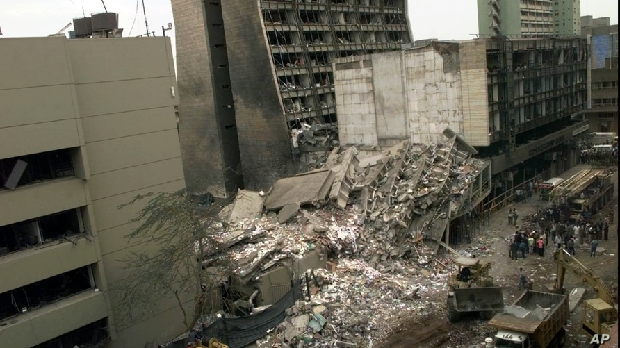 The United States Embassy, left, is pictured with blasted ruins next to it in downtown Nairobi, Kenya Saturday, Aug. 8, 1998…