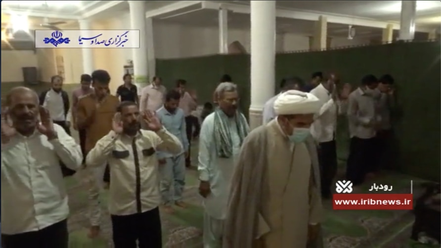 Iranian men worship without face masks at a reopened mosque in Roudbar, Kerman province in this screen grab from a May 5, 2020 report on Iranian state TV.