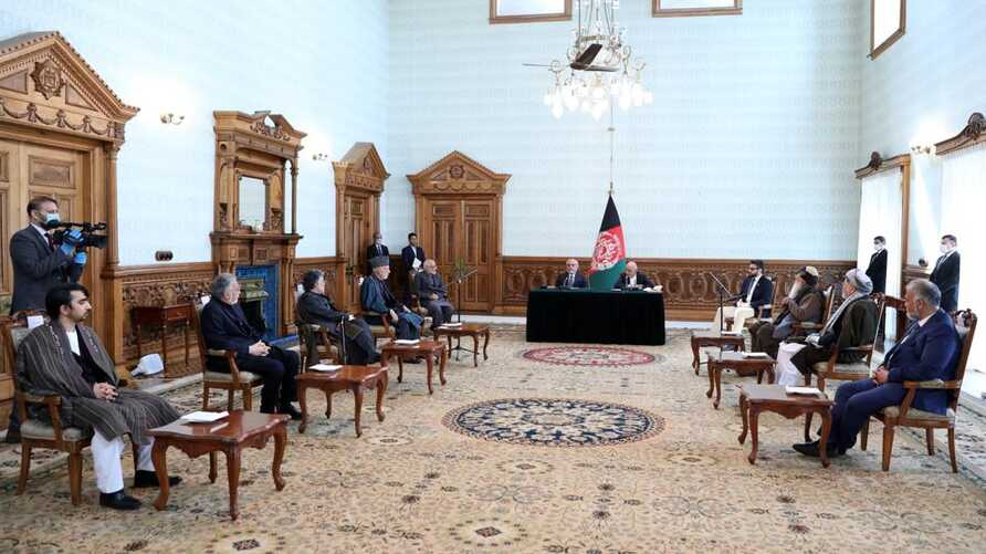 Ghani-Abdullah deal signing in Kabul, Afghanistan, May 17, 2020, in the presence of senior political figures including former President Hamid Karzai.  (Credit: Presidential Palace)
