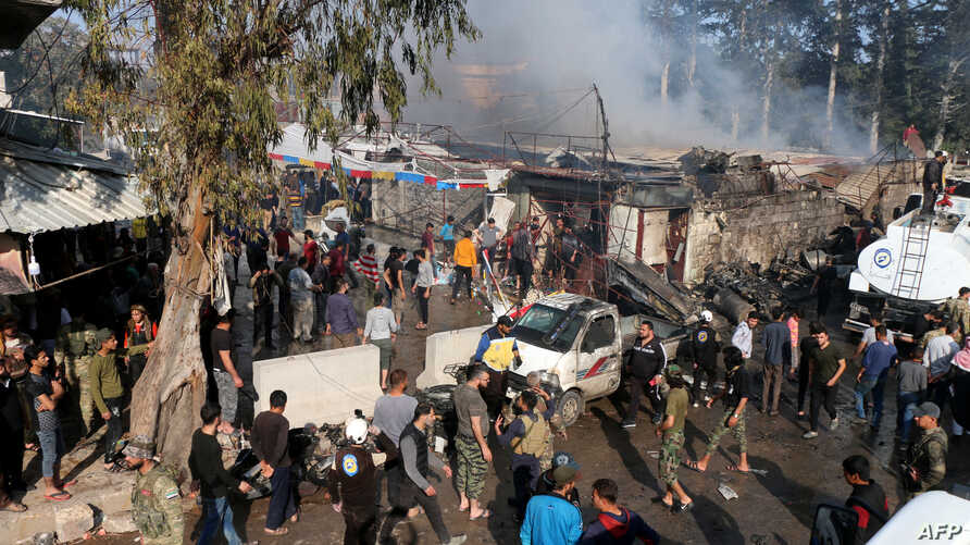 A handout picture released by the Syrian Civil Defense rescue workers shows the scene of a fuel truck explosion which killed 36 people including at least six Turkey-backed rebel fighters April 28, 2020, in the northern Syrian city of Afrin.