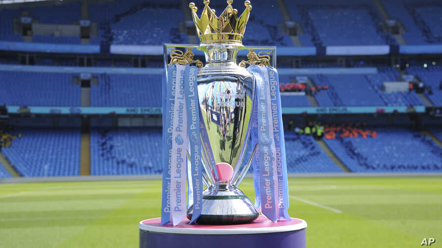 FILE - The English Premier League trophy is displayed on the pitch prior to the English Premier League soccer match between Manchester City and Huddersfield Town at Etihad stadium in Manchester, England, May 6, 2018.