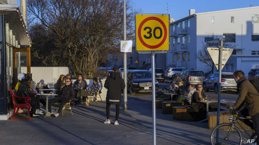 People gather at a restaurant in Reykjavik after Iceland recorded days of zero new cases of COVID-19, April 29, 2020.