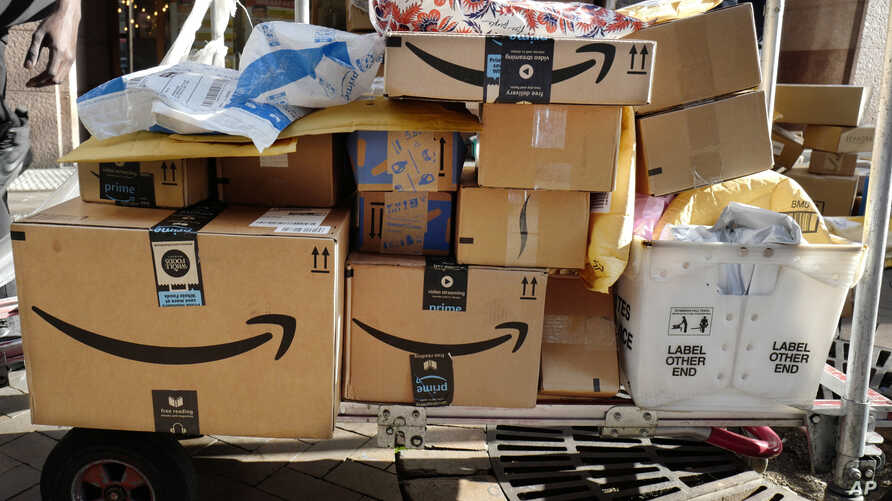 FILE - Amazon Prime boxes are loaded on a cart for delivery in New York City, Oct. 10, 2018.