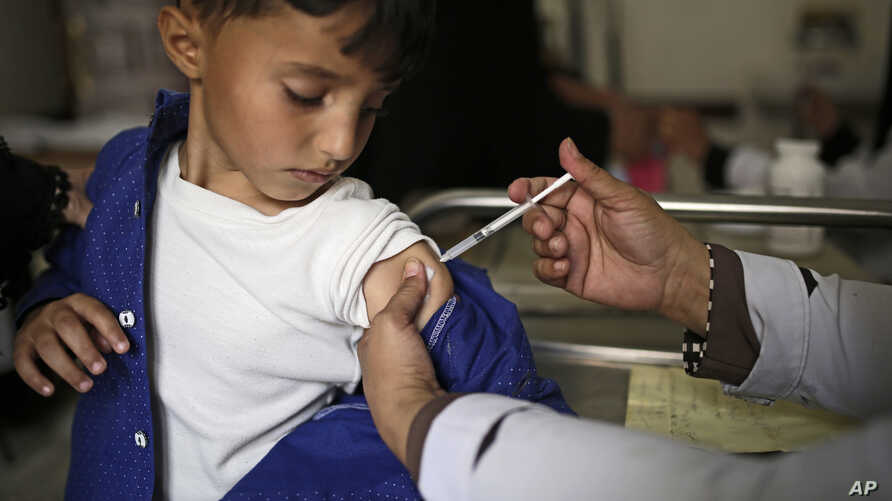 FILE - A boy receives a diphtheria vaccine at a hospital in Sanaa, Yemen, Sept. 9, 2019.