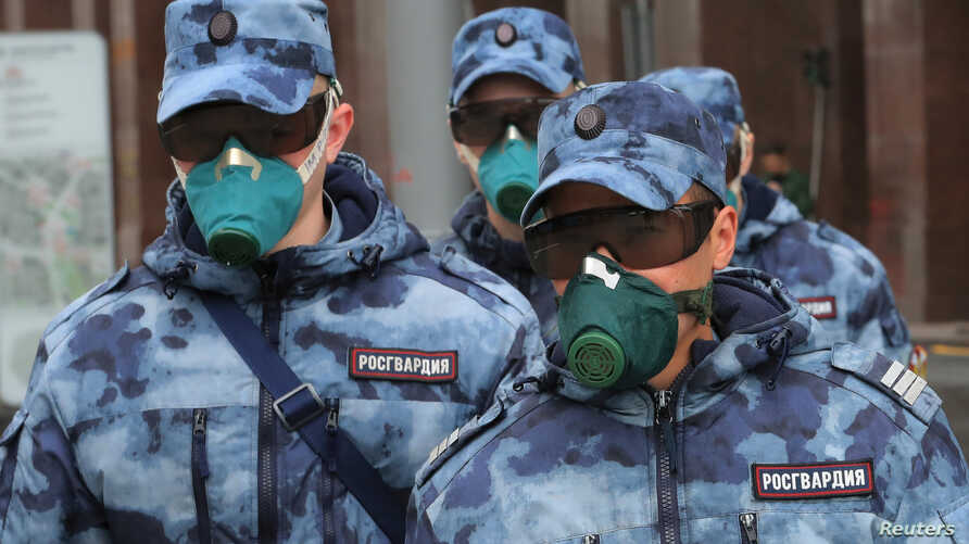 Members of Russia's National Guard wear respirators as the patrol a street during a subdued observance of the 75th anniversary of the Allied victory over Nazi Germany in World War II, amid the coronavirus pandemic, in Moscow, Russia, May 9, 2020.