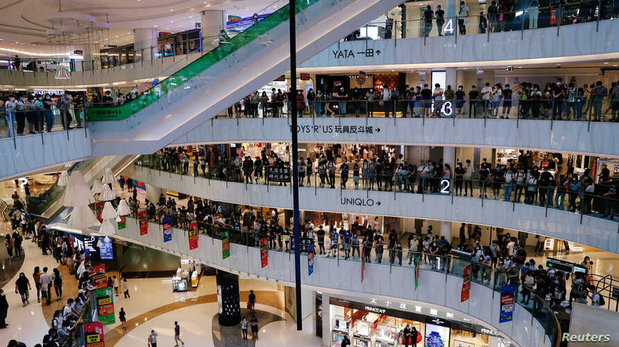 Anti-government protesters stage a rally at a shopping mall in Hong Kong.