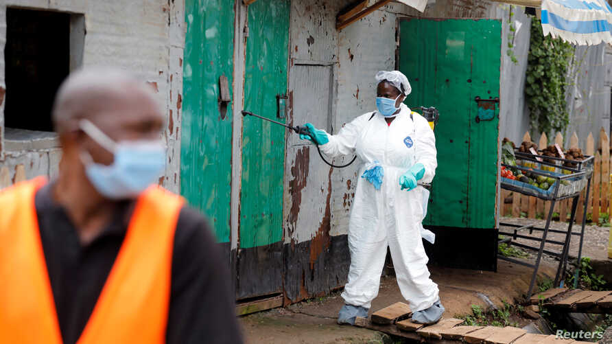 A Nairobi municipality worker sprays disinfectant in an effort to fight against the spread of the COVID-19 in the Kawangware neighborhood of Nairobi, Kenya, May 2, 2020.
