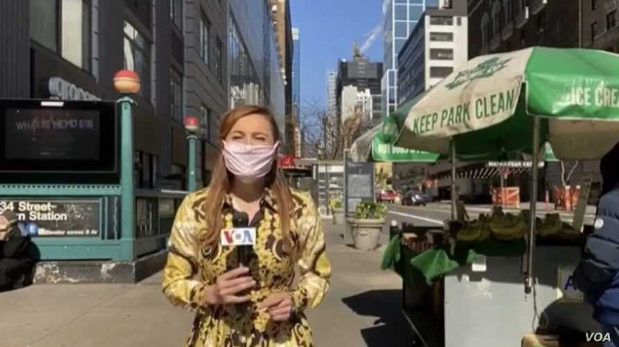 Celia Mendoza records a stand up on 34th street and 8th Ave after interviewing a street vendor about COVID and the economy.