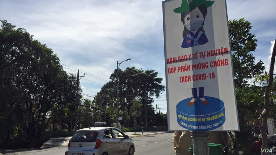 A poster in Phu Quoc, Vietnam, tells residents that filing health declarations is their contribution to the fight against COVID-19.