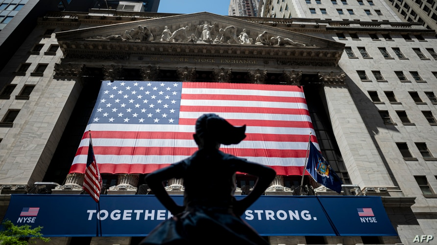 The New York Stock Exchange (NYSE) is pictures on May 26, 2020 at Wall Street in New York City. - Wall Street stocks surged…