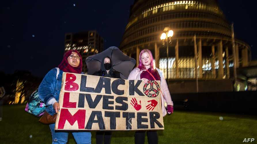 New Zealand protesters hold a vigil against the killing of Minneapolis man George Floyd in a Black Lives Matter protest outisde…