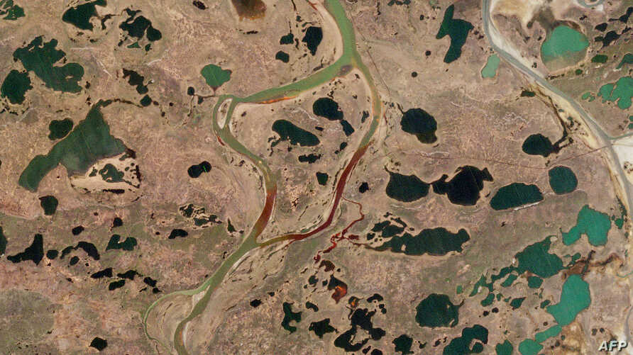 A handout photo made available by 2020 Planet Labs on June 5, 2020 shows an aerial view of the large diesel spill in the…