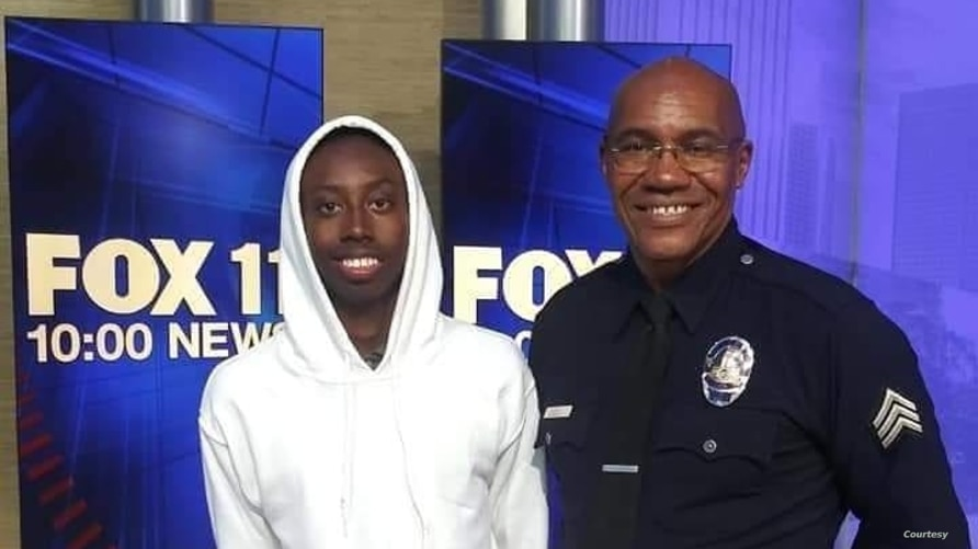 Sergeant Keith Mott with a student he mentored through Big Brothers Big Sisters of America for almost five years.