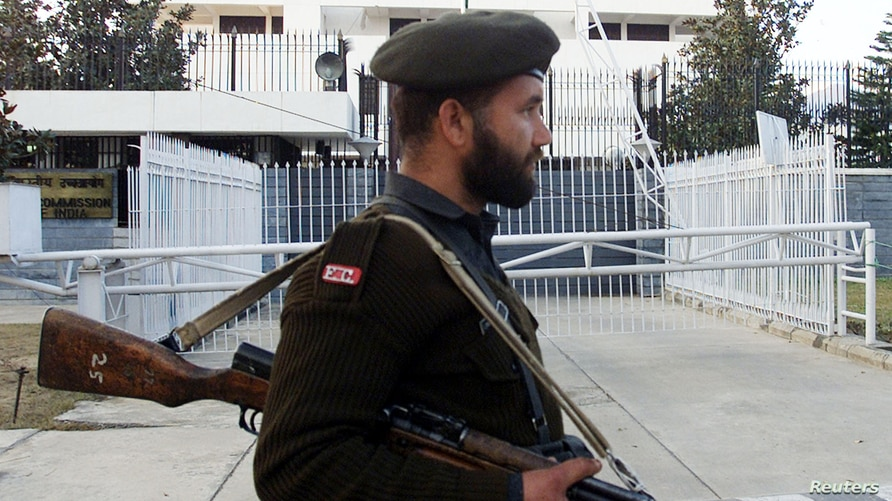 A Pakistani soldier stands guard in front of the Indian High Commissionin Islamabad February 8, 2003. India and Pakistan…