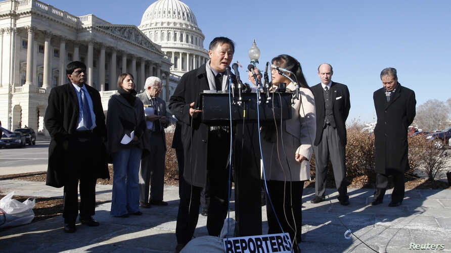 Former Chinese political prisoner and leading human rights activist Wei Jingsheng (C) speaks to the press alongside U.S…