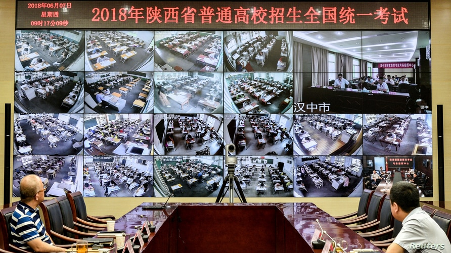 "Staff members monitor the venues as students sit for the annual national college entrance examination, or ""gaokao"", in Xian,…"