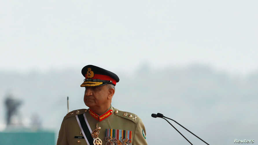 FILE PHOTO: Pakistan's Army Chief of Staff General Qamar Javed Bajwa, walks as he arrives to attend the Pakistan Day military…