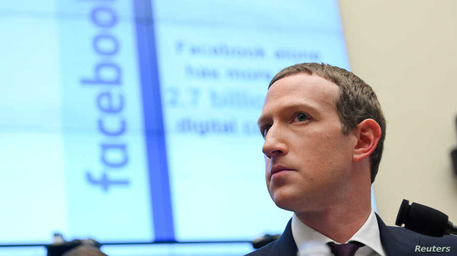 FILE - Facebook Chairman and CEO Mark Zuckerberg testifies at a House Financial Services Committee hearing in Washington.