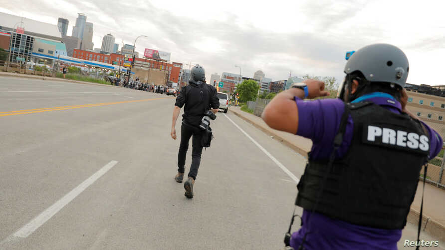 AP photojournalists John Minchillo and Julio Cortez cover continued demonstrations in reaction to the death in Minneapolis…