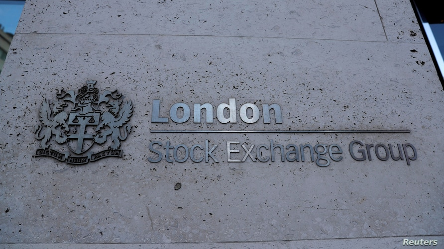 FILE PHOTO: Signage is seen outside the entrance of the London Stock Exchange in London, Britain. Aug 23, 2018. REUTERS/Peter…