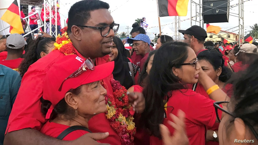 FILE - Irfaan Ali, presidential candidate for Guyana's opposition People's Progressive Party, meets with supporters, ahead of the March 2nd presidential election, in Georgetown, Guyana, Jan. 18, 2020.