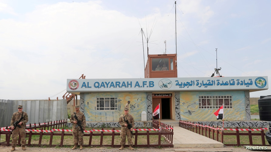 FILE PHOTO: U.S. soldiers stand guard during the hand over of Qayyarah Airfield West to Iraqi Security Forces, in the south of…