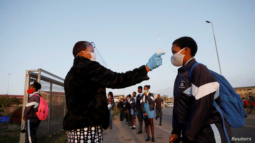 FILE PHOTO: A learner is screened as schools begin to reopen after the coronavirus disease (COVID-19) lockdown in Langa…