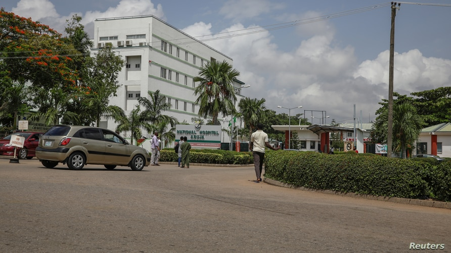 People are seen going into the National hospital after resident doctors commence a doctors strike, as coronavirus disease …
