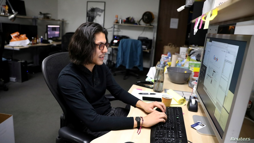 FILE PHOTO: DACA recipient Javier Hernandez Kistte works at his job in visual effects in Los Angeles, California, U.S., January…