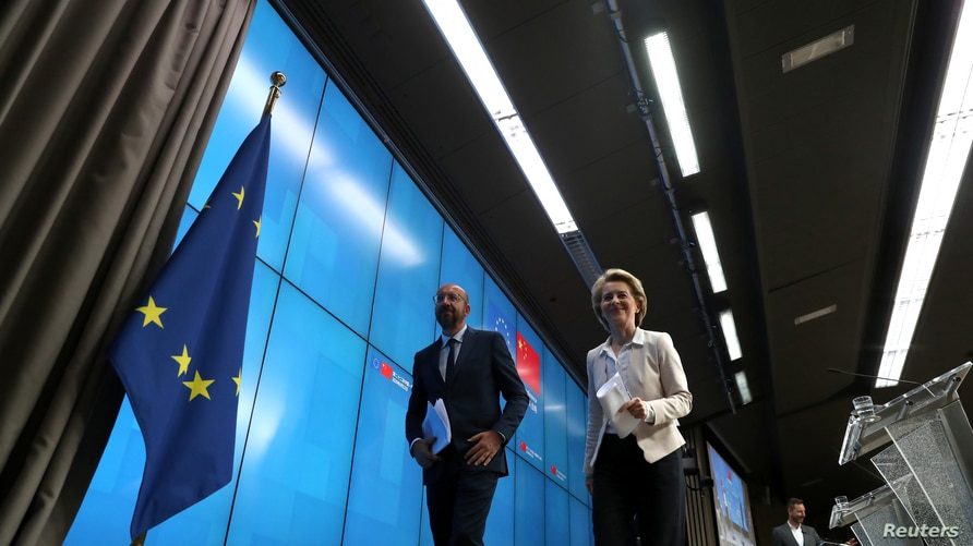 European Council President Charles Michel and European Commission President Ursula von der Leyen leave after attending a news…