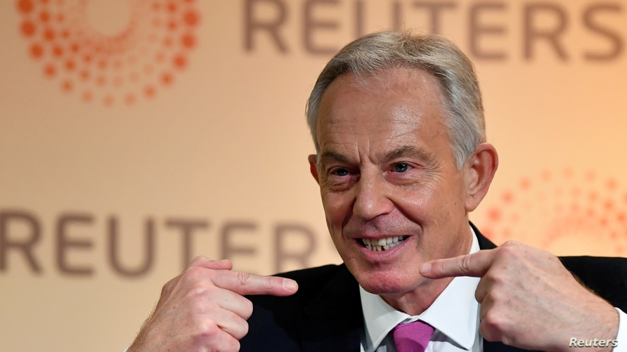 FILE PHOTO: Former British Prime Minister Tony Blair speaks during an interview with Axel Threlfall at a Reuters Newsmaker…