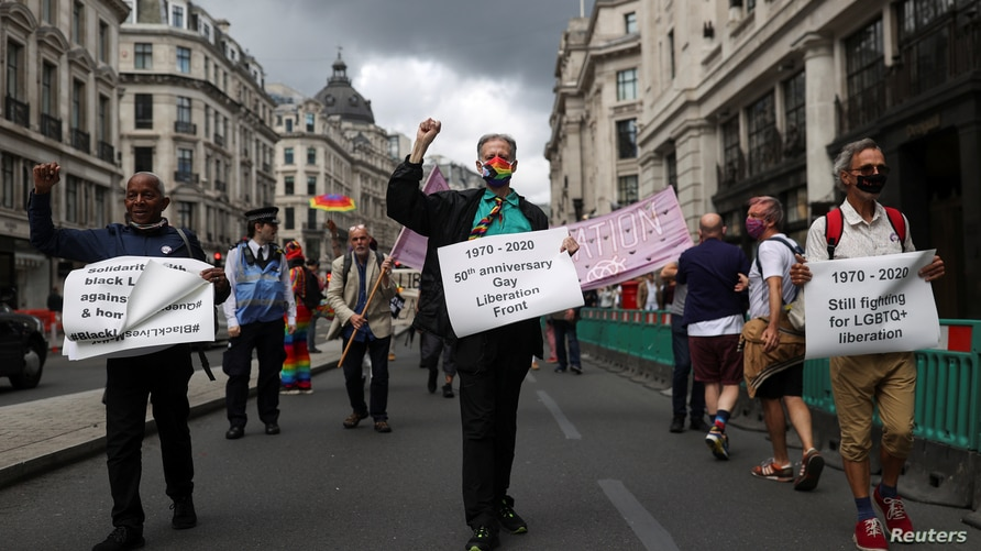Veteran British LGBT rights campaigner Peter Tatchell takes part in the Gay Liberation Front (GLF) pride march in London,…