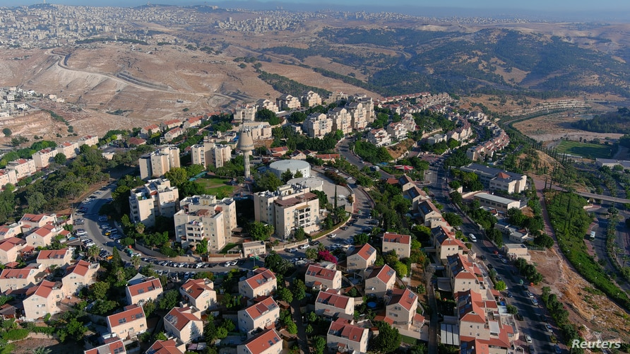An aerial view shows the Jewish settlement of Maale Adumim in the Israeli-occupied West Bank, June 29, 2020. Picture taken with…