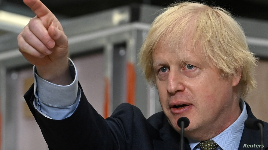 Britain's Prime Minister Boris Johnson gestures as he delivers a speech during his visit to Dudley College of Technology in…