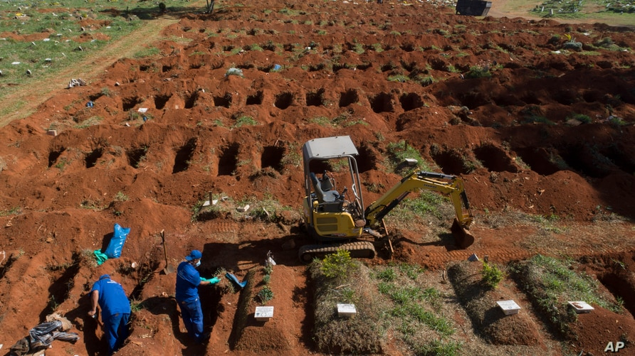 Cemetery workers exhume remains buried three years ago at the Vila Formosa cemetery, which does not charge families for the…