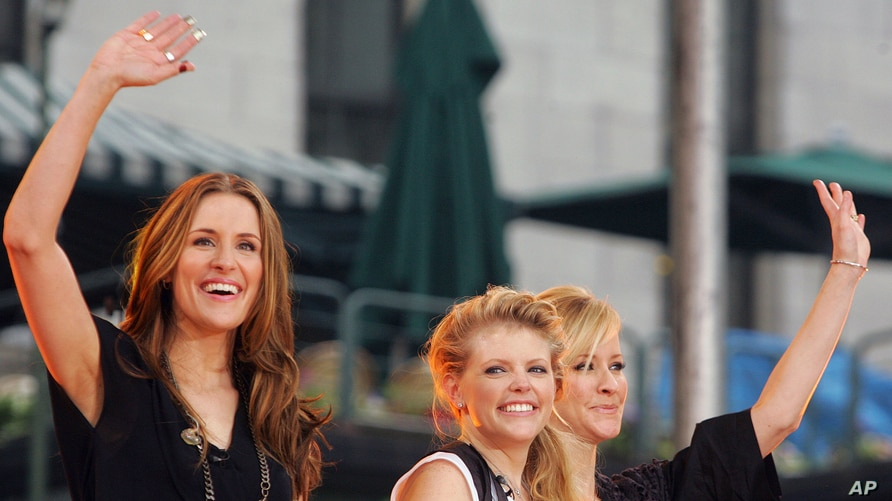 FILE - In this May 26, 2006, file photo, Dixie Chicks, from left, Emily Robison, Natalie Maines and Martie Maguire, wave to the…