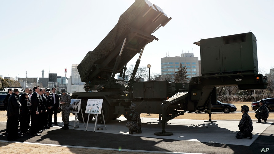 FILE - U.S. Vice President Mike Pence inspects the Patriot Advanced Capability-3 (PAC-3) missile launch system with Itsunori Onodera, Japan's defense minister, during a demonstration at the Ministry of Defense in Tokyo, Japan, Feb. 7, 2018.