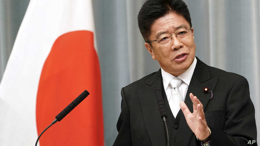 Newly appointed Health, Labor and Welfare MinisterKatsunobu Kato speaks during a press conference at the prime minister's…