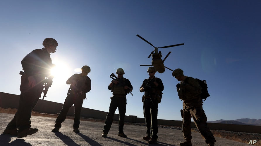 FILE - American soldiers wait on the tarmac in Logar province, Afghanistan.