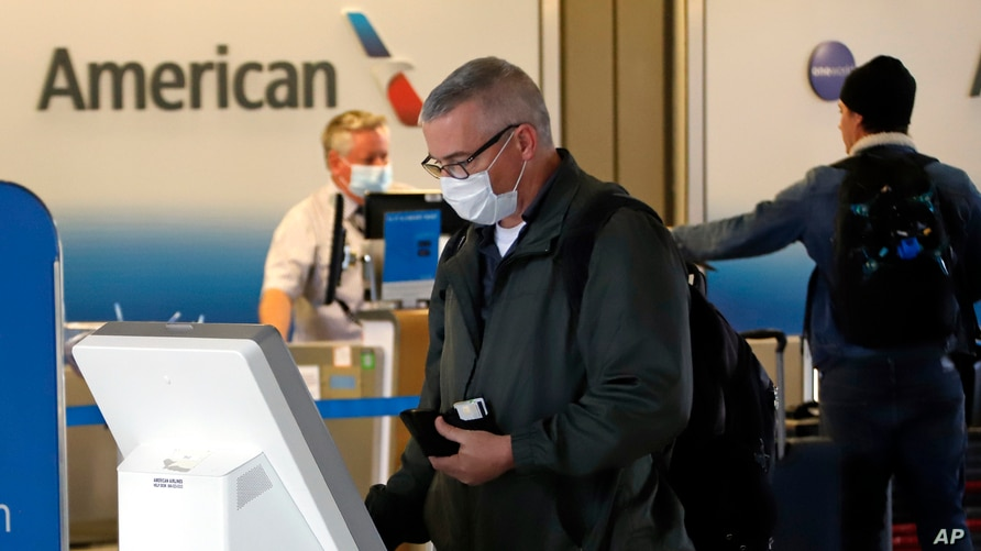 Travelers check in at the American Airline ticket counter at Greater Pittsburgh International Airport on Thursday, May 7, 2020…