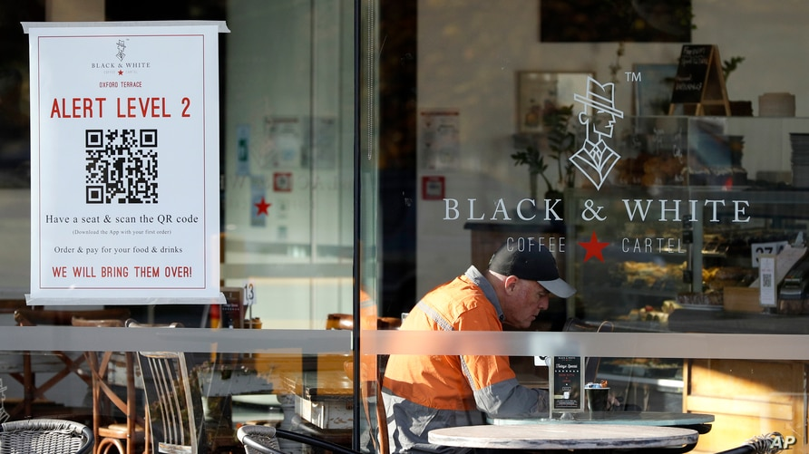 A man enjoys coffee in a cafe in Christchurch, New Zealand, May 14, 2020.